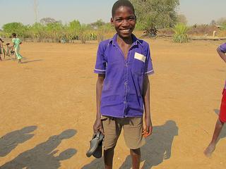 Schoolboy gets shoes for good grades