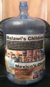Water jug used for collecting donations