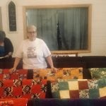 Quilts draped over the pews in a church