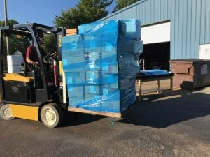 A forklift carrying medical supplies