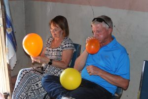 Jim and Ann Messenger blowing up balloons