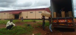 Men carrying boxes into warehouse