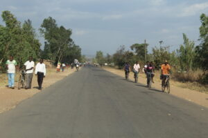People walking on either side of the narrow road