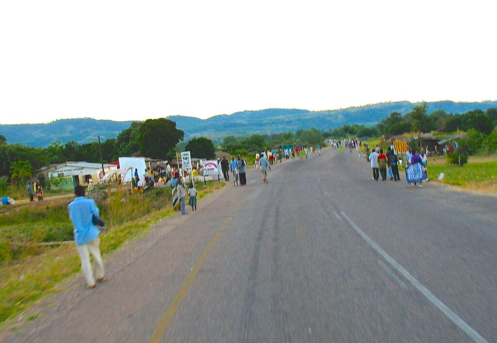 People walking on both sides of a road