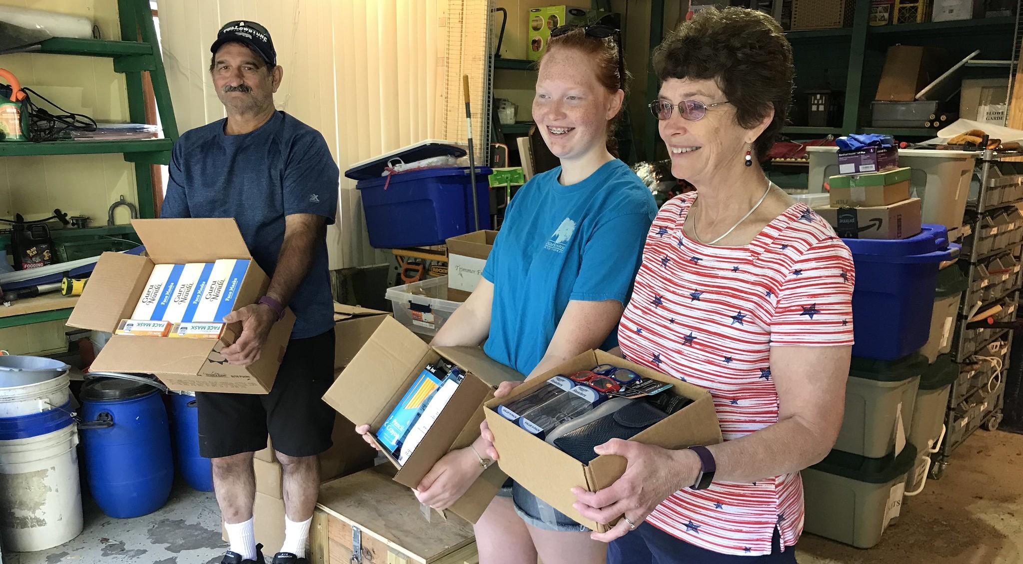 Volunteers helping to load supplies