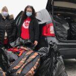 Jessie, Suzi and Cheryl transferring supplies for Malawi