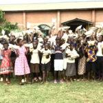 Malawian children receiving food.