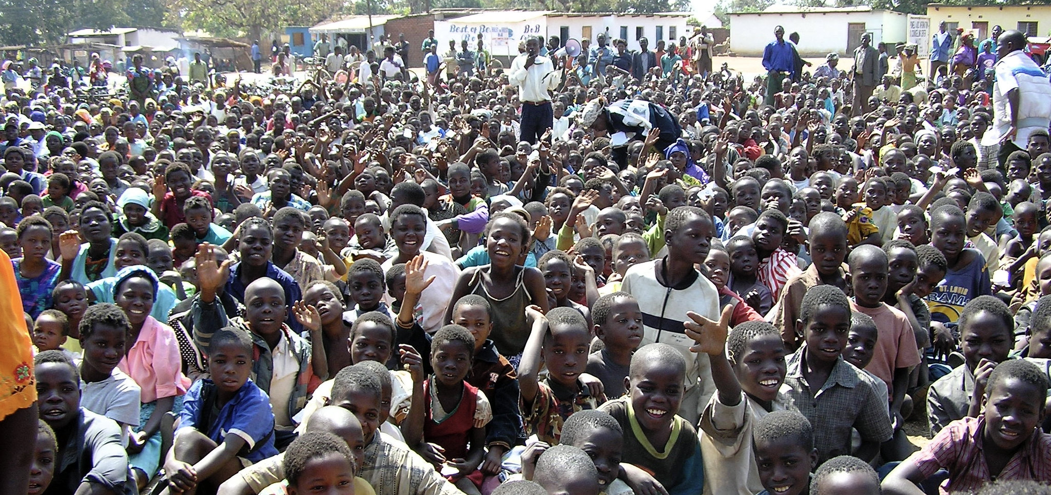 portion of the 5,000 orphan children gathered at the Mponela Trading Center a few years ago to receive food during the intense famine