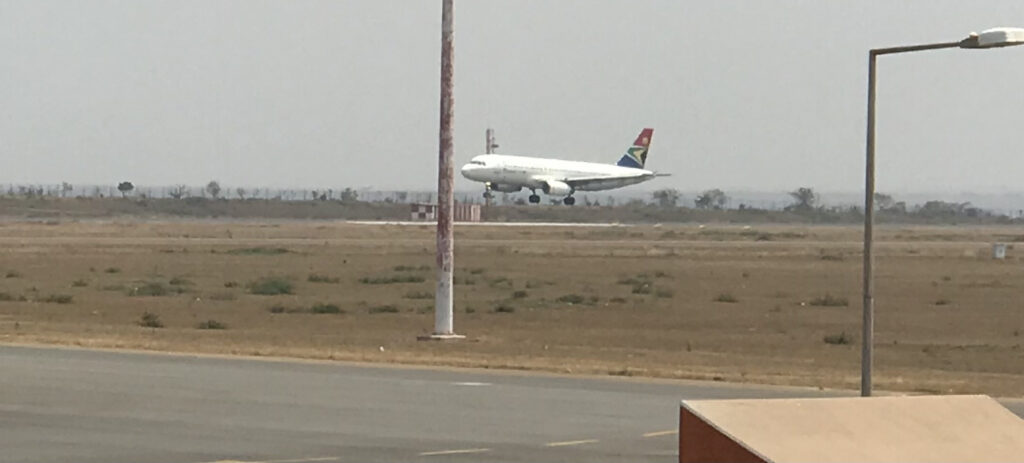 An airplane landing at an airport
